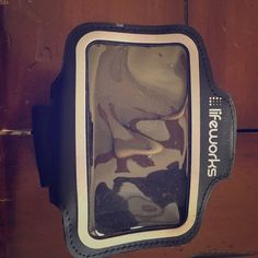 Lifeworks ipod/iphone 4 running armband Great shape. Adjustable and has a place for a key. Lifeworks  Accessories Phone Cases
