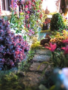 Studio E: dollhouse gardens. This site is wonderful! I love how she handled this garden.