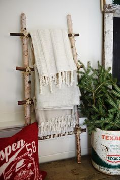 DIY ladder - See how to make this blanket ladder out of birch logs that you can find right at your craft store. So simple to make!