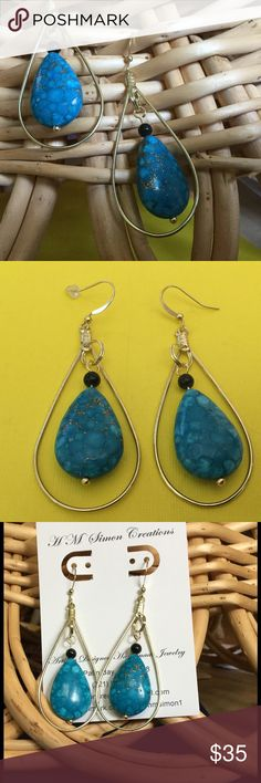 Sea Sediment Jasper and Onyx dangle earrings A-4-2 Gold veins run through these blue Sea Sediment teardrops with a natural black onyx bead accent.  The polished brass wires and rings make these ideal for daily wear. Handmade one of a kind earrings. Handmade HM Simon Jewelry Earrings