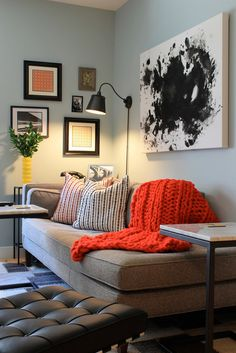 I like the gigantic knit throw and the blotchy painting on the wall (I wonder if I could do that in our kitchen)