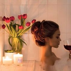 bubbles, wine, soft candle light and a messy bun - perfect night in