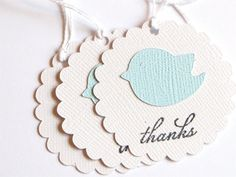 These baby shower tags are the perfect topper for your favors. Each scalloped tag features a small blue bird on white or ivory textured paper.