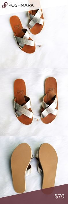 White Gold Crossover Slides (Fair Trade) Sseko Designs is an ethical fashion company empowering women in Uganda to fight the cycle of poverty. This white gold crossover slide is handcrafted from natural leather and gives a touch of sparkle to any outfit.  3&4: ssekodesigns.com  ✅Offers On Items Over $10 ✅Bundle & Save Trades Off-Posh Modeling  Shop with ease; I'm a Suggested User. Sseko Designs Shoes Sandals