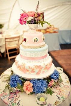Cake!!! Cake love: a vintage inspired wedding cake with edible lace decoration and a teacup topper | The Natural Wedding Company