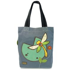 """Chala Simple Tote - Dragonfly. Lily pad in the front is a convenient pocket! Character has detailed stitching and metal button eyes. Magnetic snap closure. Side zippered pocket with leaf zipper charm. Patterned fabric lining with slide pockets & zippered pocket Materials used: Canvas cotton & textured faux leather. Colors: Indigo. Approx. Measurements: 13.5 x 3.5 x 15. Handles Drop: 9"""". Shop online at The Handbag Store at www.shopthehandbagstore.com,Go to Shop>Chala."""