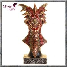 Sirath Dragon Bust Figurine Ornament 17cm High. A stunningly colourful Dragon bust with amazing detailing that has been hand painted on quality cold cast resin. In shinning reds and golds with an ornate design on the base, this Pagan, Gothic Fantasy Dragon figurine looks fantastic in any room. Size, 17cm High Approx.