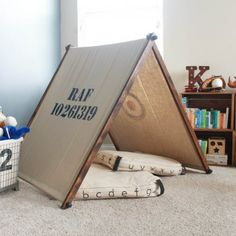This fold-up tent made with an industrial twist is perfect for the kiddos' playroom! So simple and less than $20 to make!