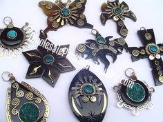 Assorted Bull's Horn Pendants- Handmade Wholesale Peruvian Jewelry http://www.wholesaleperuvianjewelry.com