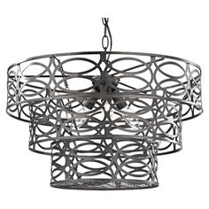 Cast a chic glow in your entryway or living room with this bold pendant, showcasing a tiered openwork shade and dark bronze finish.