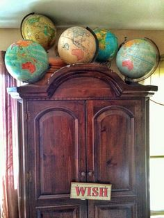 globe collection atop armoire