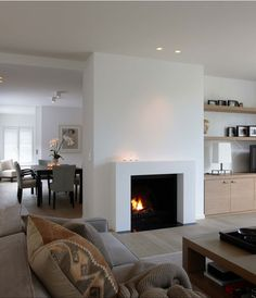 nice and simple fireplace. I also like the wooden floor. It's a bright room. Open Fireplace, Living Room With Fireplace, Fireplace Surrounds, Fireplace Design, Home Living Room, Living Spaces, Simple Fireplace, Fireplace Shelves, Living Area