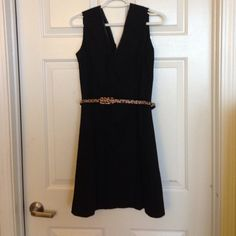 Little black dress with leather trim Stylish little black mini dress. Has a thin leather trim V neckline. Size 6 but fits like a 4. Belt not included. Limited Dresses