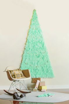 16 Clever and Creative Christmas Wall Trees via Brit + Co. Paper Garland Christmas Wall Tree