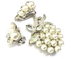Eisenberg Ice Pearl & Rhinestone Demi  Measures: Approx. Brooch 2 x 1 5/8  Earrings 1 1/8 x 5/8  Mark: Eisenberg Ice©️ - this signature dates  this beautiful set to the 1970s  Condition: Very Good with one of the tiny clear stones in the brooch appears to be a replacement this is an easy fix if it bothers you   Beautiful vintage find, a Eisenberg Ice demi parure  - Stunning brooch & earring set  - Set in lovely rhodium plated metal  - The brooch is composed of beautiful...