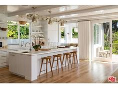 Wide-plank French-oak flooring maintains the clean, crisp color palette. Cindy Crawford's home in Malibu