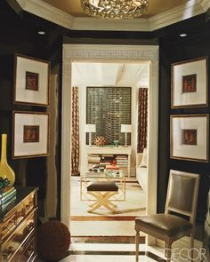 Octagonal gallery in Philip Gorrivan's apartment. Elle Decor.