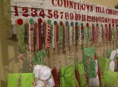 DIY Christmas Advent Calendar.  White washed old barn wood, stenciled letters, wooden clothes pins, ribbons & buttons.  Tie up small toys, candy or ornaments wrapped in tissue paper for kids to open each morning.