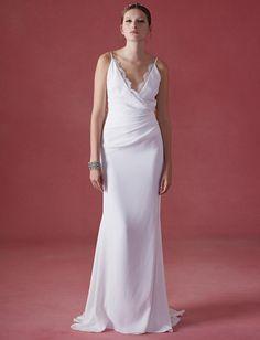 Oscar de la Renta Fall 2016 wrap wedding dress with V-neckline and ruching | https://www.theknot.com/content/oscar-de-la-renta-wedding-dresses-bridal-fashion-week-fall-2016