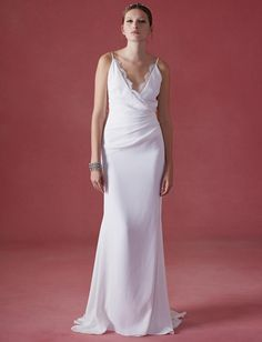Oscar de la Renta Fall 2016 wrap wedding dress with V-neckline and ruching   https://www.theknot.com/content/oscar-de-la-renta-wedding-dresses-bridal-fashion-week-fall-2016