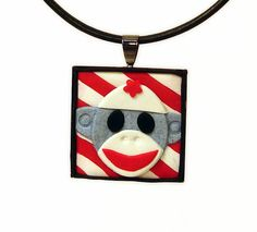 Sock Monkey Pendant Hand sculpted Blue Face in Polymer Clay by MagicByLeah