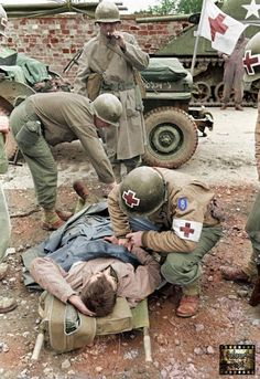 Medical Battalion, US Infantry Division in La Haye du Puits, Normandy, France July 1944 (Note the Medic's cigar) Army Medic, Combat Medic, Military Photos, Military History, D Day Normandy, Normandy France, Ww2 Pictures, American Soldiers, Us History