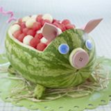 Watermelon Pig...this page has GREAT carving ideas, plus all kinds of other fun stuff.  My Mommy will be SO excited to see this!  <3