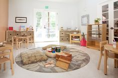 I love the rug and generally the center piece of the room. {USC Children Center Activity Area, by Kohburg}