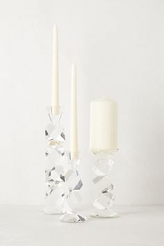 Crystal Ladder Candle Holders #anthropologie These chunky crystal candlesticks are a stylish spring transition from the all the iced branches and thick icicles ornaments we saw over the holiday season.  I wonder if they are like prisms in the sunlight?
