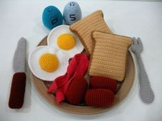 ****THIS IS A CROCHET PATTERN****  ****THIS IS A CROCHET PATTERN****  ****THIS IS A CROCHET PATTERN****  ****THIS IS A CROCHET PATTERN****  ****THIS IS A CROCHET PATTERN****      This is a crochet pattern and NOT the finished item.    Language / Instruction: ENGLISH    Skills Level: Intermediate (Must be able to understand basic crochet instructions)    Patterns includes:  1. Twin Sunny Side Up (6.5 inches)  2. Toast (4 inches)  3. Mini Sausages (2.2 inches)  4. Bacon (5.8 inches)  5. Sa...