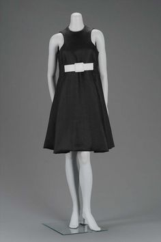 Geoffrey Beene - American 1960s. Black linen sleeveless A-line dress with white leatherbelt.