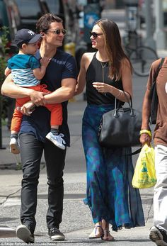 Happy family: Orlando and his wife Miranda and baby son Flynn seemed to be having fun in the Big Apple