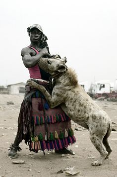 Never realised how big a hyena can get. Hyena men of Nigeria Cultures Du Monde, World Cultures, African Beauty, African Art, Hyena Man, Baboon, African Culture, Sierra Leone, People Around The World
