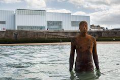 Turner Contemporary and Folkestone Triennial install life-size Antony Gormley sculptures on the Kent coast