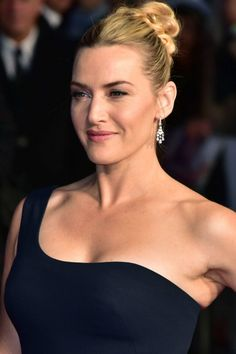 Kate Winslet takes on the classic messy bun, opting to wear her blonde hair pulled loosely back to perfectly showcase that incredible one shoulder gown.