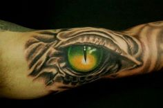 If you're looking for something a little different, a dragon eye tattoo may be just the thing. Check out SloDive's treasure chest of tattoo designs now! Eye Tattoo On Arm, Tigeraugen Tattoo, Tiger Eyes Tattoo, Cat Eye Tattoos, Third Eye Tattoos, All Seeing Eye Tattoo, Wild Tattoo, Tattoo Designs Tumblr, Heart Tattoo Designs