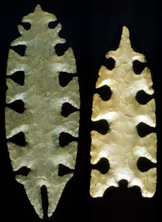 """These two forms of Tussinger eccentrics were shaped with large expanding notches around the edges. This """"first stage lacework"""" design is common on many of the eccentrics. To produce the """"lacework"""" pattern, the space between the notches would have been cut with V-shaped notches. The largest eccentric in this picture measures 4 3/4 inches (12.1 cm) long."""