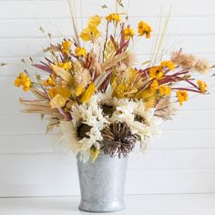 Floral arrangements are great decor for fall, especially in colors like oranges and yellows. Here's a helpful tutorial to make your own.