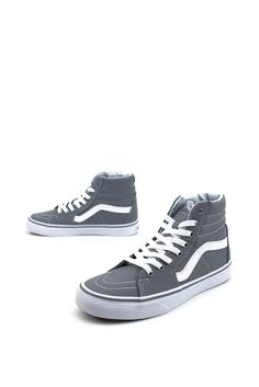 Whether you're on your deck or chillin' with your buds, it's always a good time to rock the Canvas Sk8-Hi Shoes by Vans. These classic skate kicks have a high-t