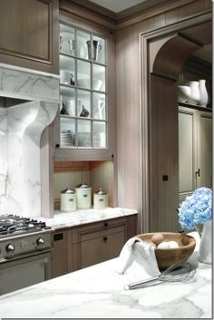 belgian oak.   very similar to our cabinets. like the hood a lot! perfect marble color with wood tone