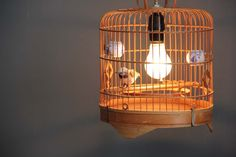 Vintage Bamboo Birdcage Hanging Light with Fabric Cord. $145.00, via Etsy.
