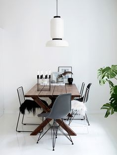 White and wood dining space in a minimalist yet cosy Finnish home.