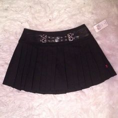 Black Pleated Skirt NWT. Brand is royal bones but was bought from hot topic. Hot Topic Skirts
