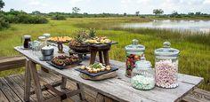Vumbura Plains, Okavango Delta, Botswana | Wilderness Safaris...Simple trellis table (Martin Adams can make in hardwood)