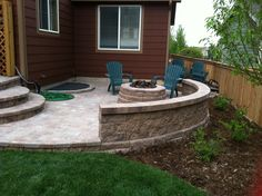 Pavers with a fire pit and sitting wall, I could do something like this with my patio.  Looks easy enough.