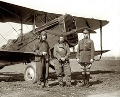 Feb. 20, 1925. Rep. P.B. O Sullivan, Gen. Billy Mitchell and Maj. Henry B. Clagett with biplane (Plover) at Bolling Field.