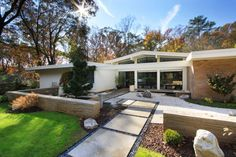 The Ridgewood house Mid century perfect - love the clean, simple landscaping #CurbAppealContest