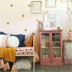 Love the vintage touches and the busy feel of this charming kids roomw