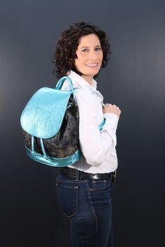 Lainie Rich, breast cancer survivor pictured with The Lainie Survivor Backpack. To order your own Lainie Survivor Backpack go to:http://www.gwenmariecollection.com/shop-1/survivor-backpack