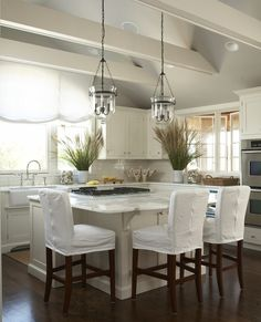 pottery barn lantern pendants, vaulted ceiling + beams i think that kitchen has beams